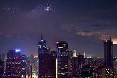 Lightning in Makati City, Philippines (Sumarie Slabber) Tags: sumarieslabber philippines lightningbolts nature skyline sky nikond750 night buildings city clouds lights manila makati fx