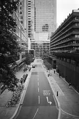 car park and taxis... (bmxhag) Tags: bw london scan kodaktrix400 olympusxa2 barbican viewpoint xa2 olympus analog film 35mm kodak trix street highrise perspective urban city plustek