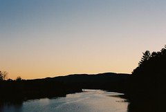Sunset on the Connecticut River (Nsharp17) Tags: nikon nikonfe film 35mm kodak ektar ektar100 connecticutriver vermont newhampshire river sunset mountains