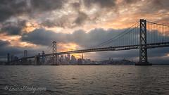 SF Bay Bridge (Laura Macky) Tags: sanfrancisco clouds sunset bayarea bridge landscape seascape
