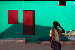 Colors. Kanyakumari, India. (Marji Lang Photography) Tags: 2013 asia capcomorin inde india kaniyakumari kanniyakumari kanyakumari marjilang tamil tamilnadu traveldestinations colorphotography colorful colorfulbackground colorfulbuilding colorfulhouse colors contrast documentary horizontal house life light lightandshadow man oneman oneperson people photography shadow silhouette street streetphotography streetshot tipofindia travel traveldestination travelphotography urbanscene wall green complementarycolors red