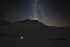 Tiny Shelter Beneath the Cold Universe (a galaxy far, far away...) Tags: otherworldly nightscape aostavalley valledaosta cold frozen snow snowy darkness alps alpine alpi plateau malatr valferret italy outdoor wilderness tent lightinthedark milkyway vialattea stars universe universo robertobertero canon nature