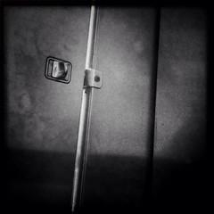 Occupied (johnny.barker) Tags: bathroom stall lock black white bw creepy latch