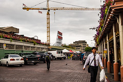 Warning Signs (Culinary Fool) Tags: construction man 18135mm stranger brendajpederson crane pikeplacemarket clouds august neon cobblestone 2016 culinaryfool seattle downtown