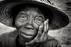 Madagascar, old lady (Dietmar Temps) Tags: africa afrika afrique madagascar tribes ethnic ethnology ethnie culture tradition traditional ritual people face blackandwhite 50mm naturallight woman lady old traditionalhat outdoor anakao vezo sakalava eyes portrait