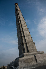 The Juche Tower  in Pyongyang, North Korea (DPRK) (tommcshanephotography) Tags: adventure asia communism dprk democraticpeoplesrepublicofkorea expedition exploring kimilsung kimjungil kimjungun northkorea pyongyang revolution secretcompass travel trekking