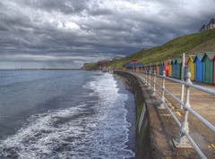 Whitby Seafront and Harbour (Ian Gedge) Tags: england uk britain imagesofengland coast seaside water whitby clouds sky sea waves beach huts harbour pier lighthouse