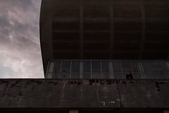 Enjoying the View (modestmoze) Tags: building architecture outside outdoors vilnius lithuania 2016 500px autumn september grey brown black white sky clouds standing looking windows frames girl girlfriend one above roof wall lines blue day