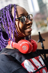 Beats girl, Howe Street (Eric Flexyourhead) Tags: vancouver canada britishcolumbia bc downtown howestreet city urban street streetphotography portrait candid streetportrait girl woman braids purple sunglasses reflections shiny smile smiling headphones shallowdepthoffield bokeh sonyalphaa7 zeisssonnartfe55mmf18za zeiss 55mmf18
