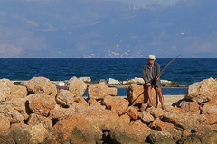 Rock fishing ... (kostakai) Tags: fishing rocks fisherman sea seascape greece