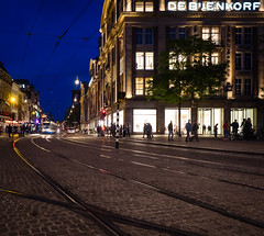 De Bijenkorf (buddythunder) Tags: travel europe 2016 wideangle netherlands amsterdam store department debijenkorf tram tracks silhouette colour leadin blue yellow building