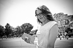 Something to Smile About (stimpsonjake) Tags: nikoncoolpixa 185mm streetphotography bucharest romania city candid blackandwhite bw monochrome smiling woman girl phone