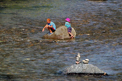 Kids and Cairns (Jan Nagalski) Tags: boy girl rock boulder river creek pink blue cairn cairns clearcreek kid kids children young golden colorado jannagalski jannagal pinkhat redhair redhead water waterfun barefoot brother sister