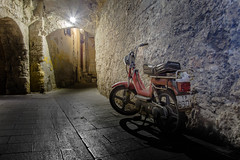 A Different Street (darren.cowley) Tags: rhodes oldtown street alley moped shadows lowlight night contrast arches brick stone walls maze historical darrencowley hidden