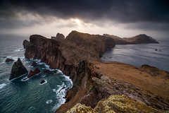 volcanic stronghold (Dennis_F) Tags: madeira atlantic ocean pontadesaolourenco sunrise clouds landscape dawn cliff cliffs sunray light shadow portugal island