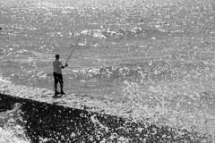 Fisherman and foam (kailhen) Tags: fisherman fishing foam sea seaside splash dawlish devon waves