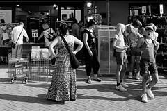 stuntin' (japanese forms) Tags: street girls summer bw men beach monochrome strand digital blackwhite women random candid blondes streetphotography shorts agfa cheap brunettes stunt pun streetshot bargainbasement stuntin agfafilm strasenfotografie ©japaneseforms2013