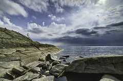 Drifting to a halt (Appe Plan) Tags: wood light summer sky sun seascape nature water clouds landscape puddle nikon rocks warm ray view sweden warmth sunny wideangle karlstad shore burst hdr appe samyang photomatrix d700