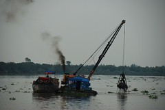Dredging the Mekong (derekwt) Tags: blue river industrial smoke vietnam pollution mekong