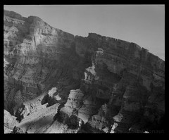 Jebel Shams, Oman (tsiklonaut) Tags: world travel bw cliff mountains 120 blancoynegro film nature analog landscape blackwhite al asia desert pentax drum scanner scenic middleeast rocky canyon scan arabic east erosion experience lucky arabia roll medium format 100 analogue arabian 6x7 oriental middle peninsula oman 67  shams discover  jebel  11000 hajar  drumscan shd omani sultanate  pmt  hajjar     photomultipliertube  scanview scanmate  japanesearabicrussian