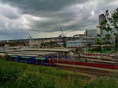 Tram and train. (Keefy243) Tags: approaching storm clouds midland station train tram sheffieldsouthyorkshireuk