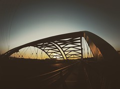 Summer vibe (Blockshadows) Tags: russian peleng fisheye 8mm angle wide wideangle traffic road overpass tones moody muted mutedtones black sunset summer colorado denver speer bridge
