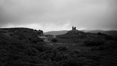 Castle Varrich (DrupkaTheUnclear) Tags: scotland bw castle ruin north gothic moody atmosphere cloud rain forest road telephoto