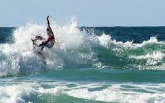 Newquay Surfer (Wilamoyo) Tags: ocean water spray waves tide sea surf surfing sport athletic green blue sky splash
