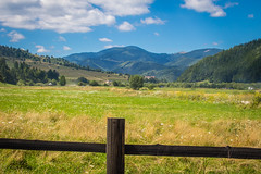Ove the Hills and Far Away (AlexAncuPhoto) Tags: cloud clouds white blue sky cloudy sunny mountain mountains hills hill green tree trees forest evergreen pine fir gold golden grass field fields fence brown wood landscape travel zarnesti moieciu romania