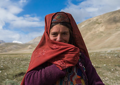 Portrait of a wakhi nomad woman, Big pamir, Wakhan, Afghanistan (Eric Lafforgue) Tags: 3034years adult adultsonly afghan afghan249 afghani afghanistan anthropolgy badakhshan bigpamir braidedhair centralasia colourimage community cultures hat headscarf horizontal indigenousculture ismaili lifestyles lookingatcamera malongzan nomad nomadicpeople oneperson onewomanonly outdoors people photography portrait poverty red shy traditionalclothing veil waistup wakhancorridor wakhi women womenonly wakhan pamir