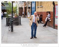 Man On The Phone (G Dan Mitchell) Tags: man telephone converse talk sidewalk london england uk unitedkingdom westend people street photography travel
