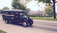 Cruising Around the Village (11Jewels) Tags: canon 18200 panning vehicle vintagebus greenfieldvillage dearbornmi michigan