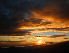 2016_10_03_lhr-ewr_161 (dsearls) Tags: 20161003 lhrewr sunset altittude flying newyork newjersey aerial windowseat windowshot united ual unitedairlines aviation wing airplane boeing boeing767 blue sky orange clouds pink altostratus altocumulus stratus sun