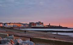 DSC_0831 (stephanie.burgess97) Tags: aberystwyth ceredigion wales uk sunset promenade buildings hotels rocks sea beach people groynes breakwater pier castle seaside coast