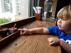 Condiments at the Ramen Bar (quinn.anya) Tags: sam toddler ramenbar hotsauce pointing chopsticks