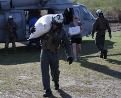 Sailors unload supplies from an MH-60 Seahawk in the aftermath of Hurricane Matthew . (Official U.S. Navy Imagery) Tags: ussiwojima mh60 marines sailors hsc28 helicopterseacombatsquadron28 worldfoodprogram usaid haiti hurricanematthew portauprince wfp support humanitarianrelief 24thmeu seahawk ht