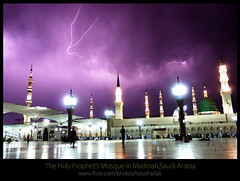 The_Holy_Prophet's_Mosque_Madinah-1003 (ArabianLens.com) Tags: reflection horizontal architecture outdoors photography dawn islam religion images mosque illuminated east getty medina spirituality middle saudiarabia distant traveldestinations almadinah buildingexterior placeofinterest largegroupofpeople colourimage gulfcountries incidentalpeople madinahmedinahajjmuslimislammohammedpbuhmakkahsaudiarabiaislamicartitechuremasjidnabawimosquerawlashaerifjennahziyarathminaretsgreendomeminaretspeople clearskyrawlasharifumbrella