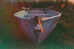 Row Your Boat (Earth Wanderer Photography) Tags: light lake grass vintage boat pond rust canoe lightleak rowboat edit sunflare