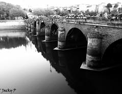 Between two banks (Pierrot 49) Tags: city bridge architecture angers smartphone river blackandwhite blackandwhiteonly noiretblanc monochrome france