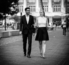 (graveur8x) Tags: couple candid street man woman blackandwhite tall frankfurt germany deutschland streetphotography strase bw dof laugh funny happy suit city people olympus olympusm75mmf18 olympusem10markii omd microfourthirds m43