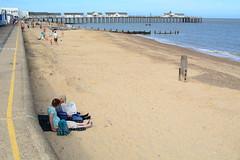 Newspaper on the Beach (Bob Hawley) Tags: summerholidays suffolk southwold southwoldpier seaside beaches holidaymakers sand sea nikond7100 nikon24f28 people reading newspapers