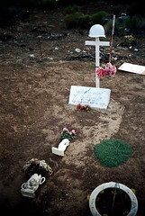 34-054 (ndpa / s. lundeen, archivist) Tags: nick southwestutah southwesternunitedstates ivins cemetery graveyard washingtoncounty indian nativeamerican grave graves tombstone tombstones marker markers gravemarker gravemarkers desert indiancemetery nativeamericancemetery shivwits paiute flowers shivwitspaiuteindiancemetery shivwitspaiute reservation indianreservation shivwitsindianreservation crawfordsnow vietnamveteran diedinvietnam military soldier helmet cross ph purpleheart 1972