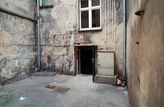 Wrocaw, Poland. (wojszyca) Tags: contax g2 zeiss biogon 21mm fuji fujicolor c200 wideopen yard urban decay urbex wrocaw housing residential door