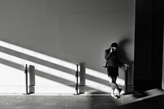 the phone call (Dean Forbes) Tags: seattle capitolhill woman phone parkinggarage bw candid sunlightshadows
