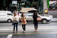 Take care (midgley.derek) Tags: ta260159 women ladies girls street crossing rain umbrella cold wet careful slippery moving motion blurred cars traffic streetphotography cautious caution melbourne australia