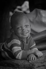 a little boy (ddimblickwinkel) Tags: nikon d300s d300 tamron portrt personen outdoor africa afrika thiopien ethiopia sunshine art natur natural nik boy blackwhite bw sw schwarzweiss black white schwarz weis vintage tribe einfarbig
