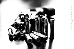 old skool (MadVick) Tags: white black monochrome canon eos guns bullet revolver ammo magnum firearm smithwesson 50d