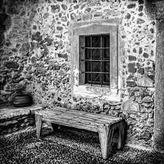 Le banc (Lucille-bs) Tags: europe grce greece crte creta kriti 500x500 nb bw monitoplou monastre grille fentre banc mur pav pot architecture