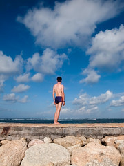 _0033470 (Two people two cameras) Tags: indonesia bali asia travel photography photo nature sanur beach sea seaside summer vacation man standing swimsuit sky blue clouds