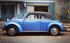 Beetle convertible in Berlin (boloveselvis) Tags: softtop vw convertible volkswagen blue metallic hubcaps chrome hub caps d3100 nikon digital conversion color colour d3100nikon nikond3100 3100 camera